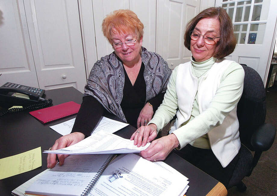 From left, Wilton registrars of voters Carole Young-Kleinfeld and Tina Gardner work on voter data at Wilton Town Hall.
