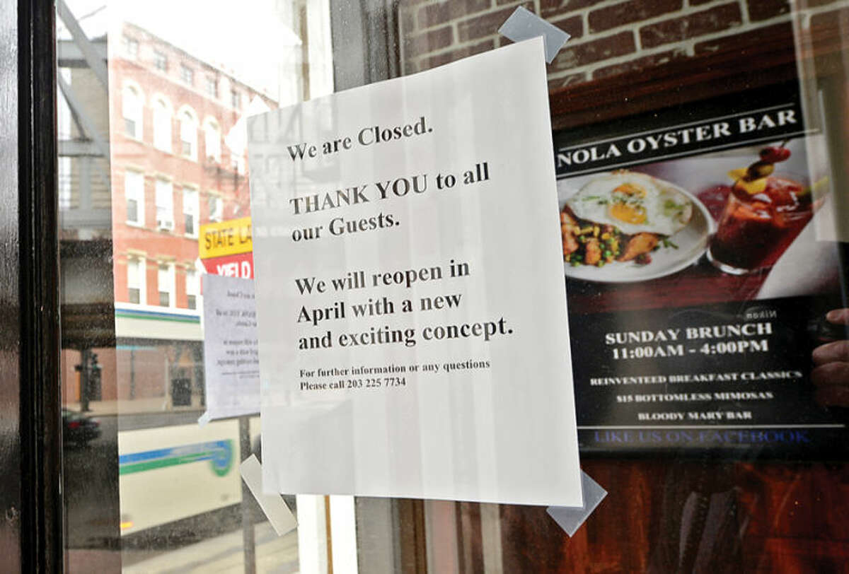 Hour photo / Erik Trautmann Nola Oyster House at 68 Washington St. in SoNo has closed but vowed to reopen as something else. Some businesses are finding hard to keep their doors open while others look to reinvent themselves.