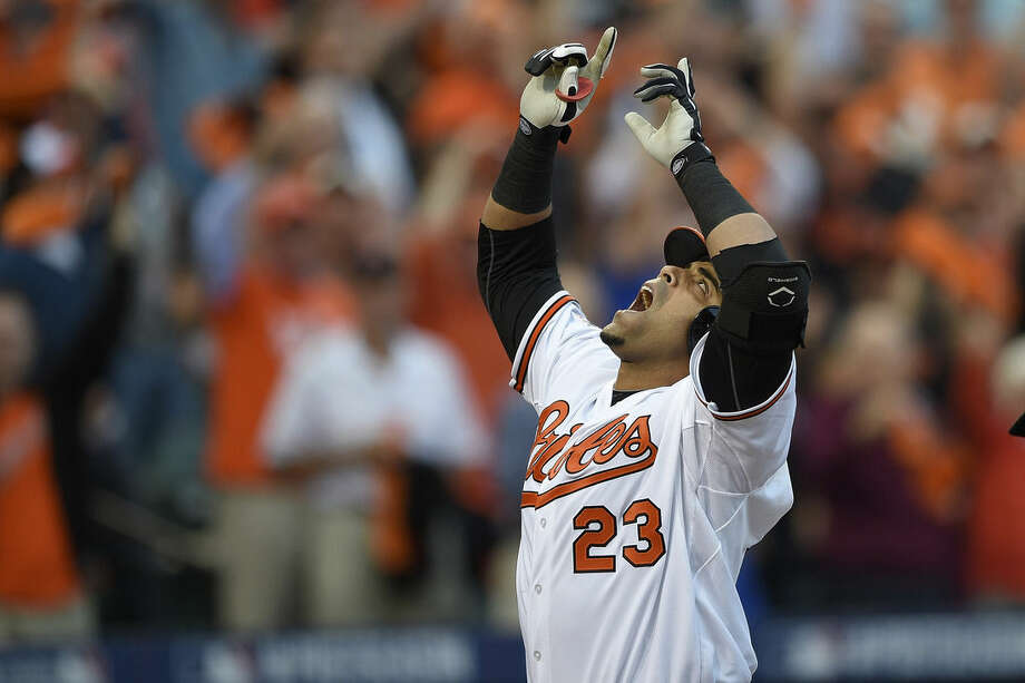 FILE - In this Oct. 2, 2014, file photo, Baltimore Orioles designated hitter Nelson Cruz gestures after his two-run home run in the first inning against the Detroit Tigers during Game 1 of baseball's AL Division Series in Baltimore. Major League Baseball heading towards opening day. From Cuba to Canada, from the Bay Area to the snow-besieged Northeast, great expectations abound. (AP Photo/Nick Wass, File)