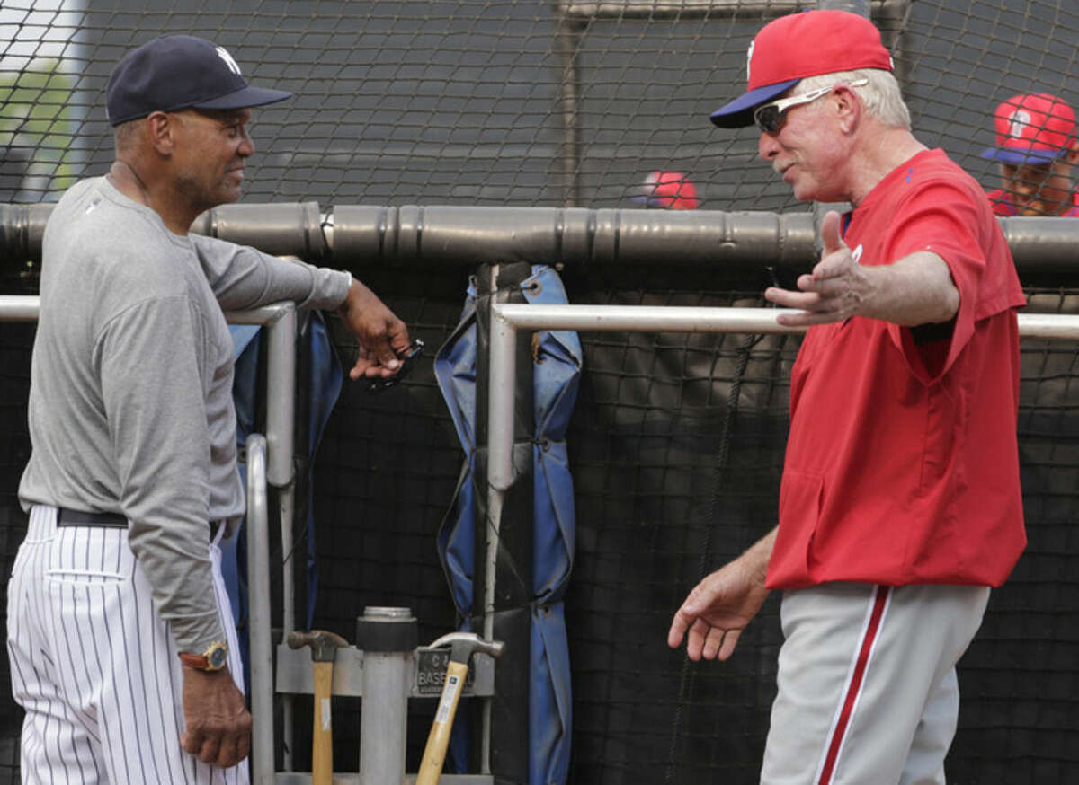 FILE - In this March 19, 2015, file photo, Hall of Famers Reggie Jackson, left, and Mike Schmidt chat behind the batting cage before an exhibition baseball game between the New York Yankees and the Philadelphia Phillies in Tampa, Fla. Major League Baseball regular season begins with opening day on April 5, 2015. (AP Photo/Kathy Willens, File)