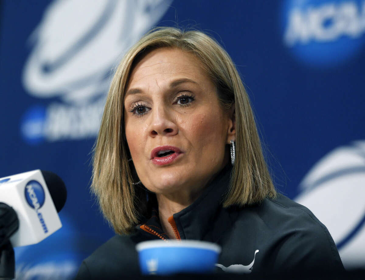 Texas head coach Karen Aston speaks during a news conference for a women's college basketball regional semifinal game in the NCAA Tournament on Friday, March 27, 2015, in Albany, N.Y. Texas plays Connecticut on Saturday. (AP Photo/Mike Groll)
