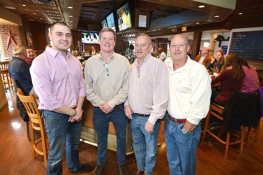 Hour Photo/Alex von Kleydorff At the new location for Bogey's Grille and Tap Room General Manager Tyler Moss, and Jimmy Stablein, John Stablein and Kevin Rusch, Co Owners