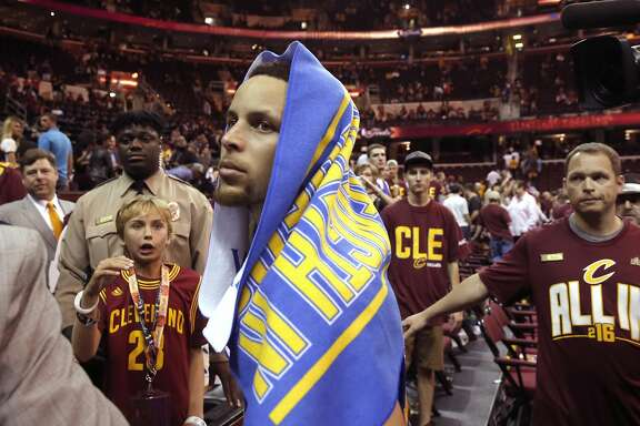 Warriors' Stephen Curry walks past Cleveland fans as he heads to the locker room as the Golden State Warriors  beat the Cleveland Cavalier 108-97 in game 4 of the NBA Championship at Quicken Loans Arena in Cleveland, Ohio on Fri. June 10, 2016.