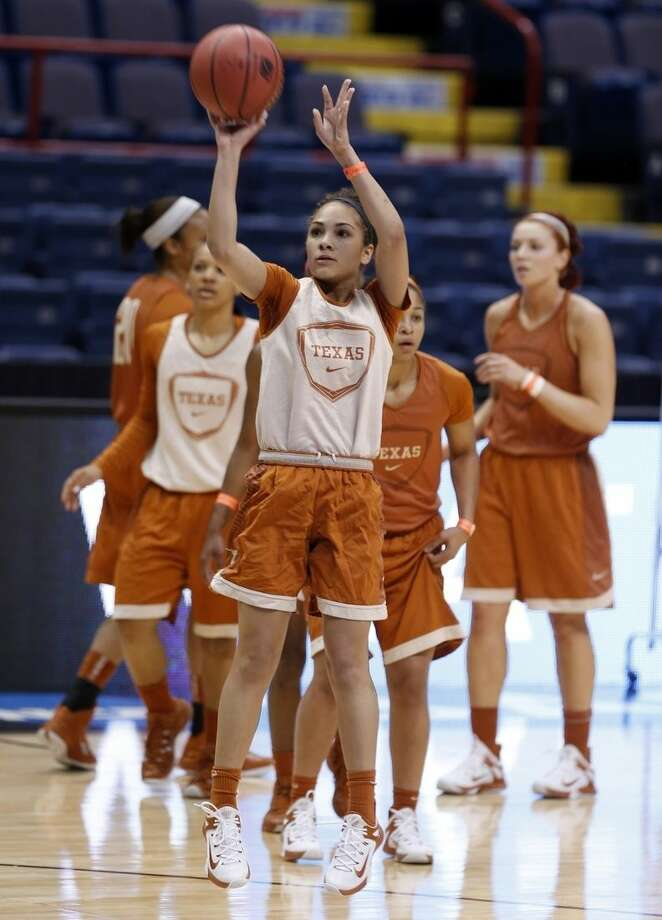 Texas guard Brooke McCarty shoots during practice for a women's college basketball regional semifinal game in the NCAA Tournament on Friday, March 27, 2015, in Albany, N.Y. Texas plays Connecticut on Saturday. (AP Photo/Mike Groll)