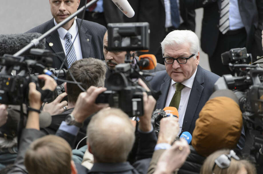 German Foreign Minister Frank-Walter Steinmeier speaks to journalists as he arrives for a new round of nuclear talks with Iran in Lausanne, Switzerland, Saturday, March 28, 2015. (AP Photo/Keystone, Jean-Christophe Bott)