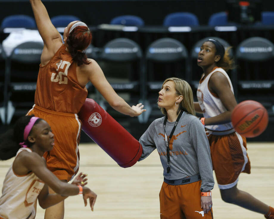 Texas head coach Karen Aston runs practice in preparation for a women's college basketball regional semifinal game in the NCAA Tournament on Friday, March 27, 2015, in Albany, N.Y. Texas plays Connecticut on Saturday. (AP Photo/Mike Groll)