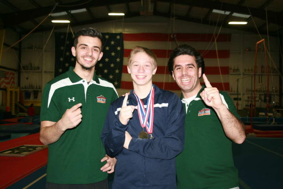 Photo 1:  Seth Warren with coach Mike Christiano and head coach Nate Laurent, after winning the Connecticut State Level 7 13+ gold medal in All-Around.
