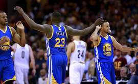 Warriors Andre Iguodala, 9 Draymond Green, 23 and Stephen Curry, 30 celebrate during the fourth quarter as the Golden State Warriors went on to beat the Cleveland Cavalier 108-97 in game 4 of the NBA Championship at Quicken Loans Arena in Cleveland, Ohio on Fri. June 10, 2016.