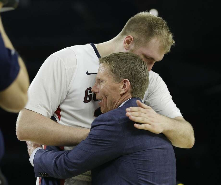 Gonzaga head coach Mark Few hugs Przemek Karnowski after a college basketball regional semifinal game against UCLA in the NCAA Tournament Friday, March 27, 2015, in Houston. Gonzaga won 74-62. (AP Photo/David J. Phillip)