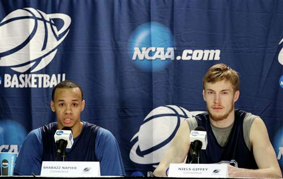 Connecticut's Shabazz Napier, left, and Niels Giffey, right, respond to questions during a news conference at the NCAA college basketball tournament in Buffalo, N.Y., Friday, March 21, 2014. Connecticut plays Villanova in a third-round game on Saturday. (AP Photo/Frank Franklin II) / AP