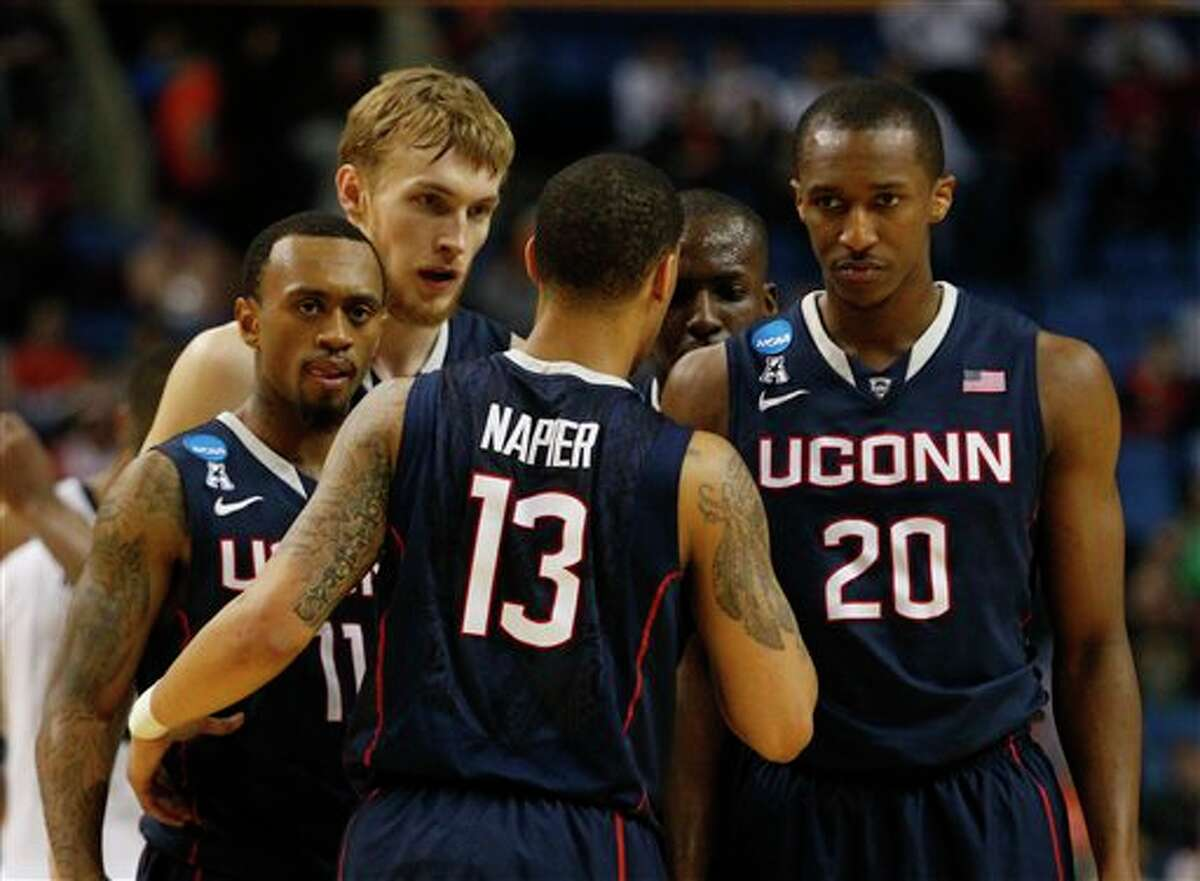 Connecticut guard Shabazz Napier (13) talks with Ryan Boatright (11), Niels Giffey (5) and Lasan Kromah (20) during the second half of a third-round game in the NCAA men's college basketball tournament in Buffalo, N.Y., Saturday, March 22, 2014. Connecticut defeated Villanova, 77-65. (AP Photo/Bill Wippert)