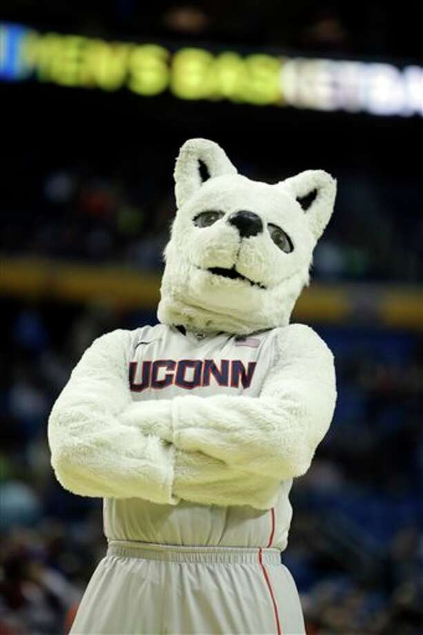 Connecticut's mascot poses during the first half of a second-round game against Saint Joseph's in the NCAA college basketball tournament in Buffalo, N.Y., Thursday, March 20, 2014. (AP Photo/Nick LoVerde) / FR1171125 AP