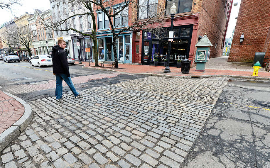 Hour photo / Erik Trautmann The Norwalk Department of Public Works looks to repave, install new crosswalks on Washington Street immediately after F.D. Rich & Co. finishes latest phase of The Pearl this June .