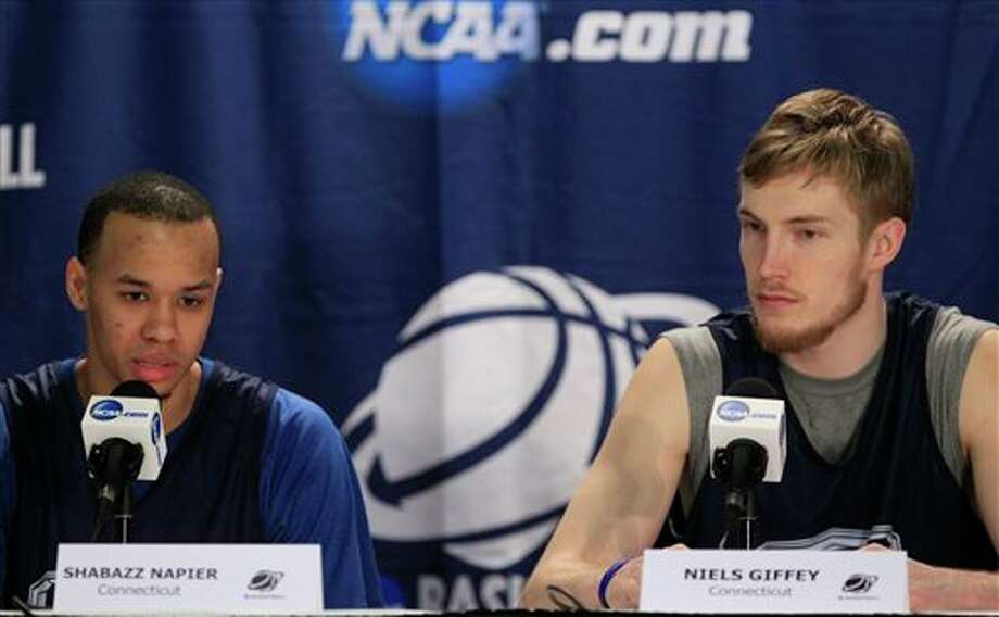 Connecticut players Shabazz Napier, left, and Niels Giffey speaks during a media session during the the men's NCAA college basketball tournament at First Niagara Center in Buffalo, N.Y., Friday, March 21, 2014. (AP Photo/The Buffalo News, Harry Scull Jr.) / The Buffalo News