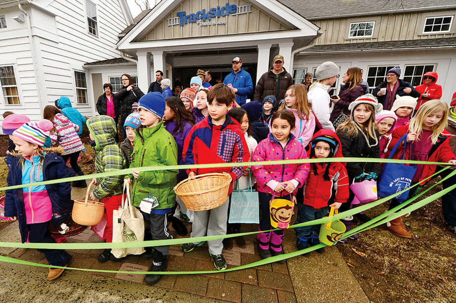 Hour photo / Erik Trautmann Children prepare for Wilton Republican Town Committee Easter Egg Hunt at Trackside Teen Center Saturday.