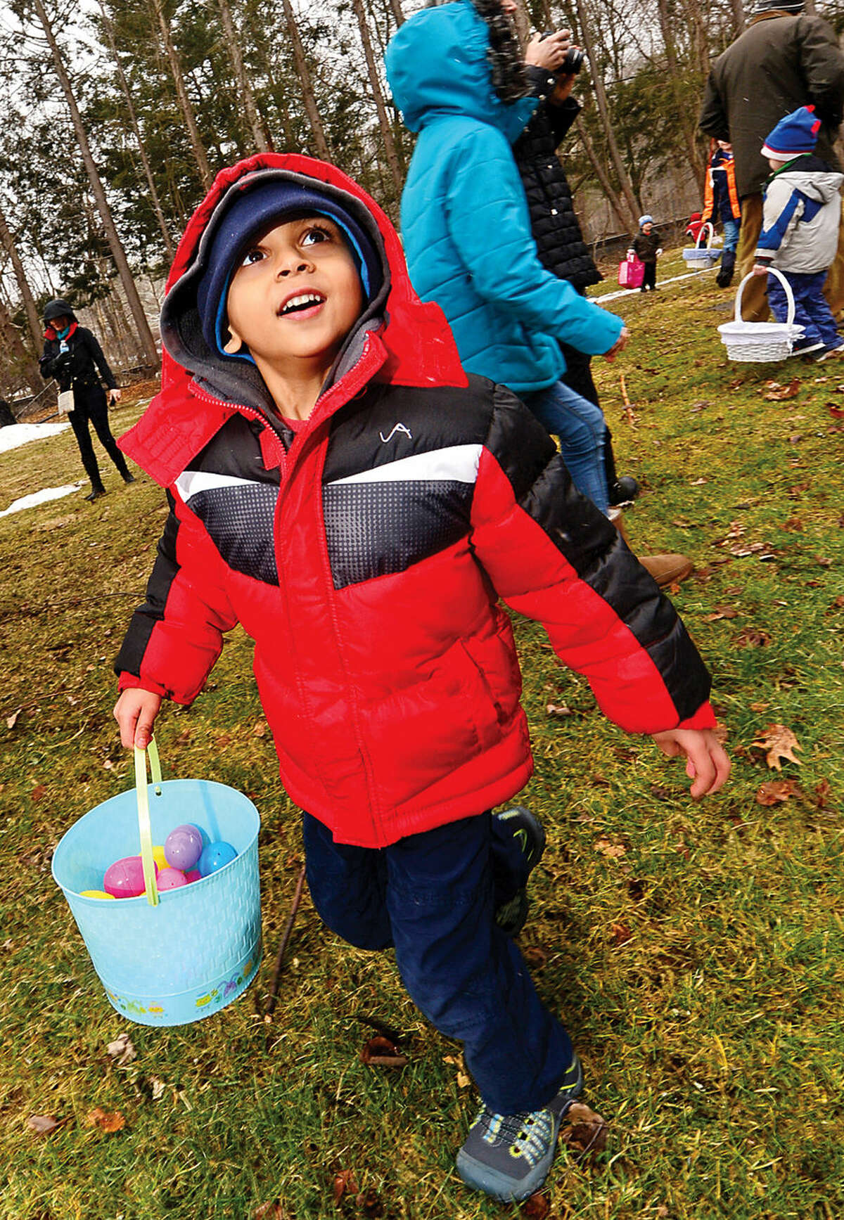 Hour photo / Erik Trautmann Neal Kaoud searches for eggs during the Wilton Republican Town Committee Easter Egg Hunt at Trackside Teen Center Saturday.