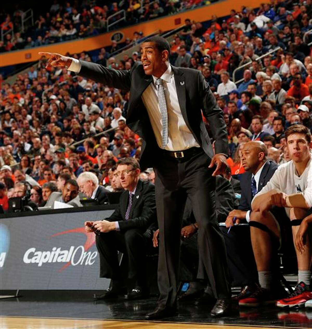 Connecticut head coach Kevin Ollie instructs his team during the second half of a third-round game in the NCAA men's college basketball tournament in Buffalo, N.Y., Saturday, March 22, 2014. Connecticut defeated Villanova, 77-65. (AP Photo/Bill Wippert)