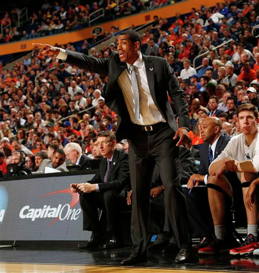 Connecticut head coach Kevin Ollie instructs his team during the second half of a third-round game in the NCAA men's college basketball tournament in Buffalo, N.Y., Saturday, March 22, 2014. Connecticut defeated Villanova, 77-65. (AP Photo/Bill Wippert) / FR170745 AP