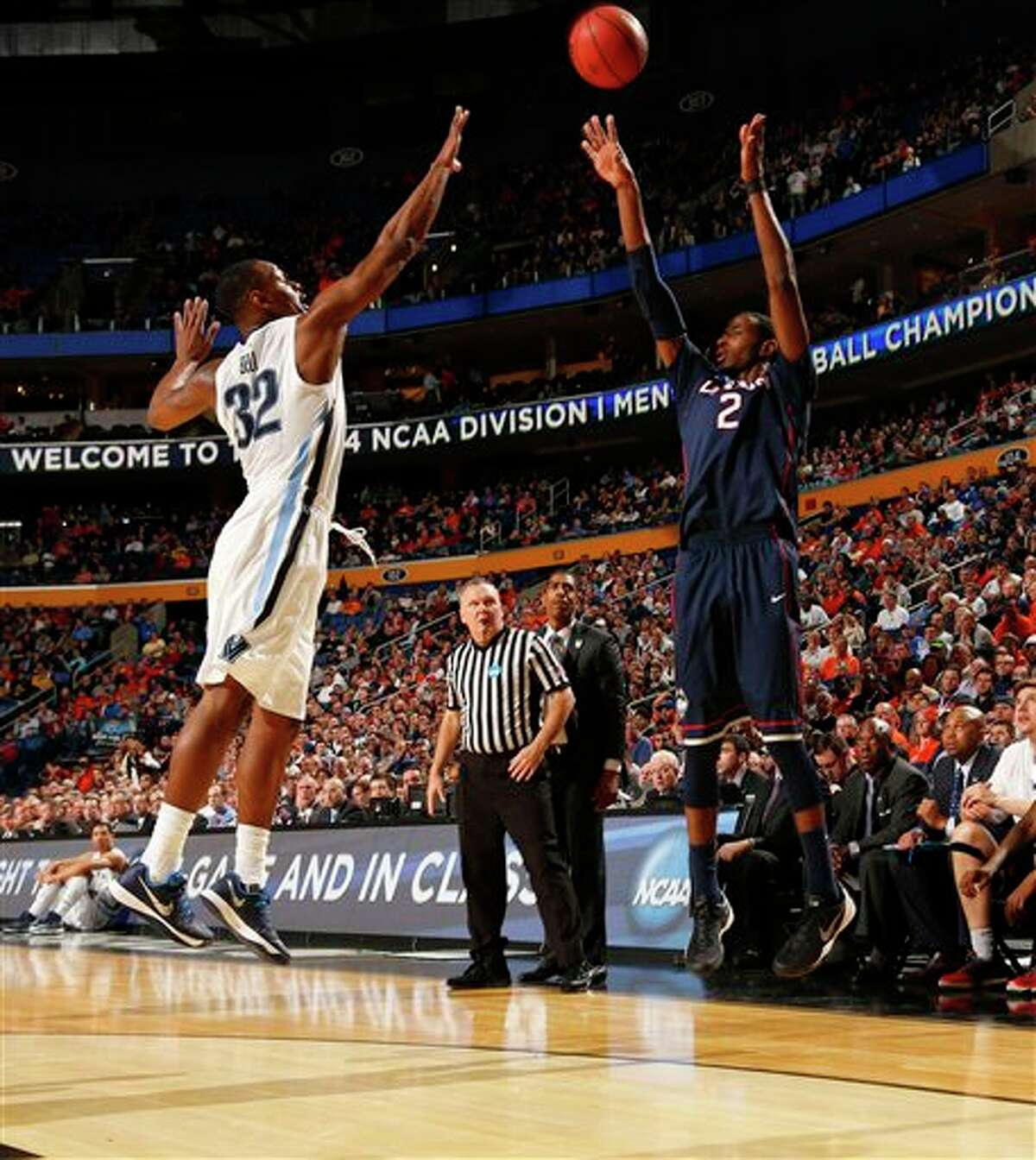Connecticut forward DeAndre Daniels (2) shoots against Villanova guard James Bell (32) during the second half of a third-round game in the NCAA men's college basketball tournament in Buffalo, N.Y., Saturday, March 22, 2014. Connecticut defeated Villanova, 77-65. (AP Photo/Bill Wippert)