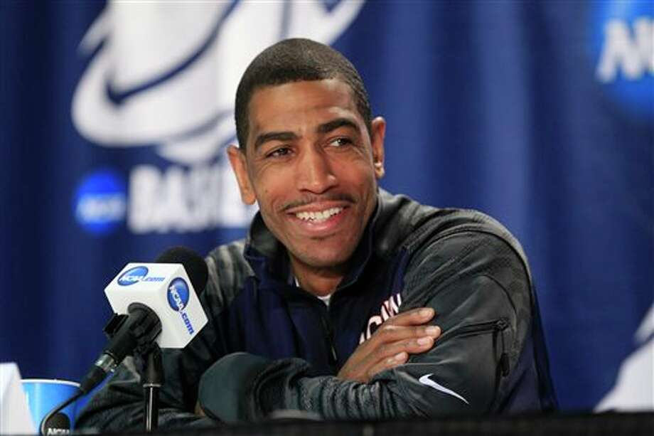 Connecticut players Kevin Ollie speaks during a media session during the the men's NCAA college basketball tournament at First Niagara Center in Buffalo, N.Y., Friday, March 21, 2014. (AP Photo/The Buffalo News, Harry Scull Jr.) / The Buffalo News