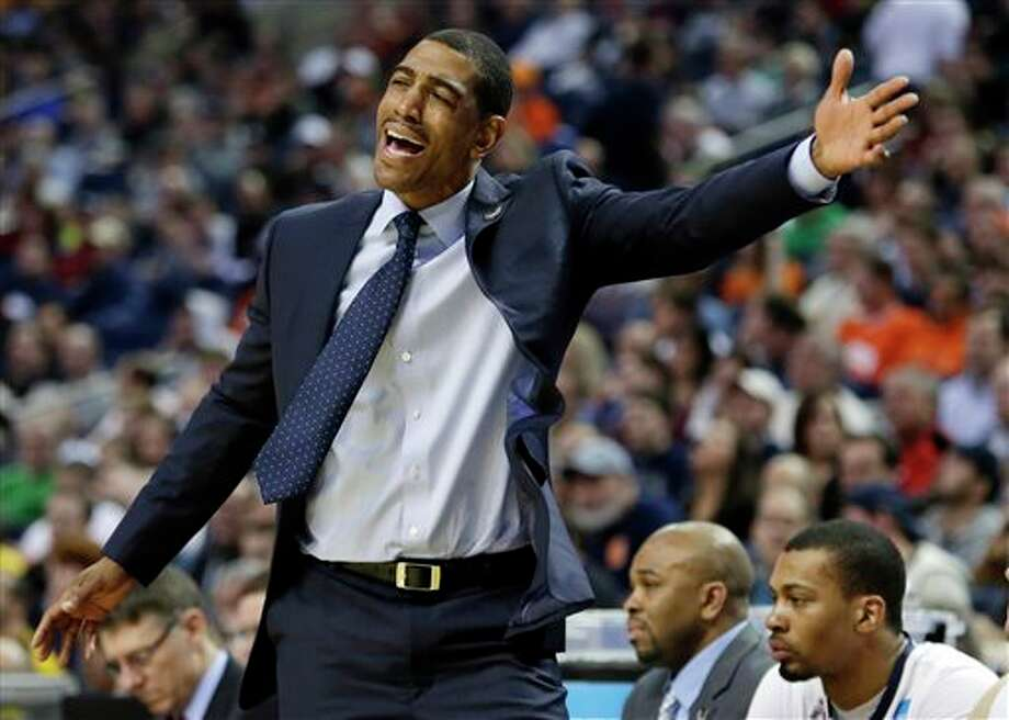 Connecticut head coach Kevin Ollie reacts to a call during the first half of a second-round game against Saint Joseph's in the NCAA college basketball tournament in Buffalo, N.Y., Thursday, March 20, 2014. (AP Photo/Nick LoVerde) / FR1171125 AP