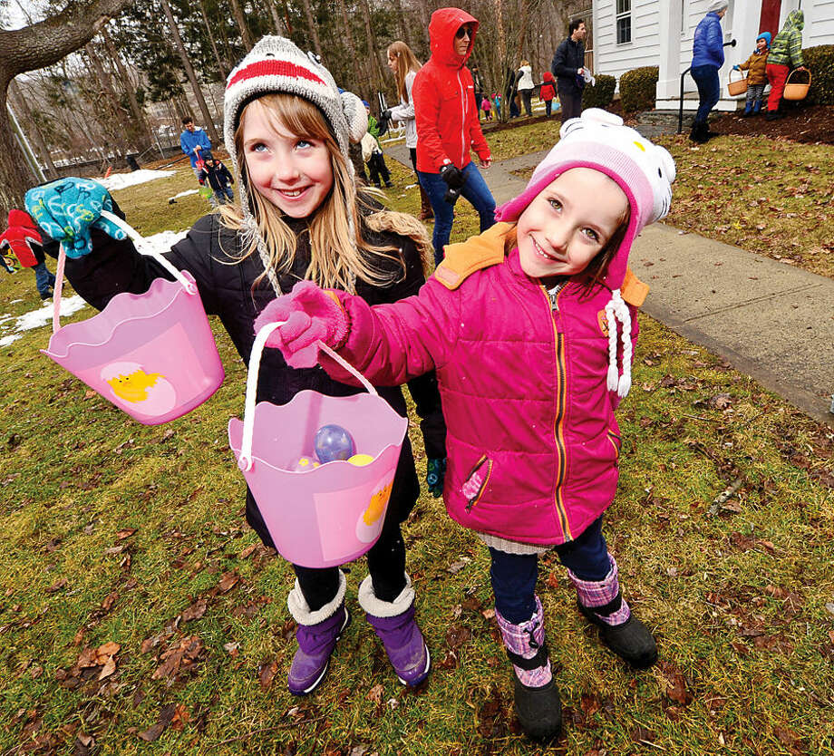 Hour photo / Erik Trautmann Lacy and Annabell Shultz, 7 and 5, display their take during the Wilton Republican Town Committee Easter Egg Hunt at Trackside Teen Center Saturday.