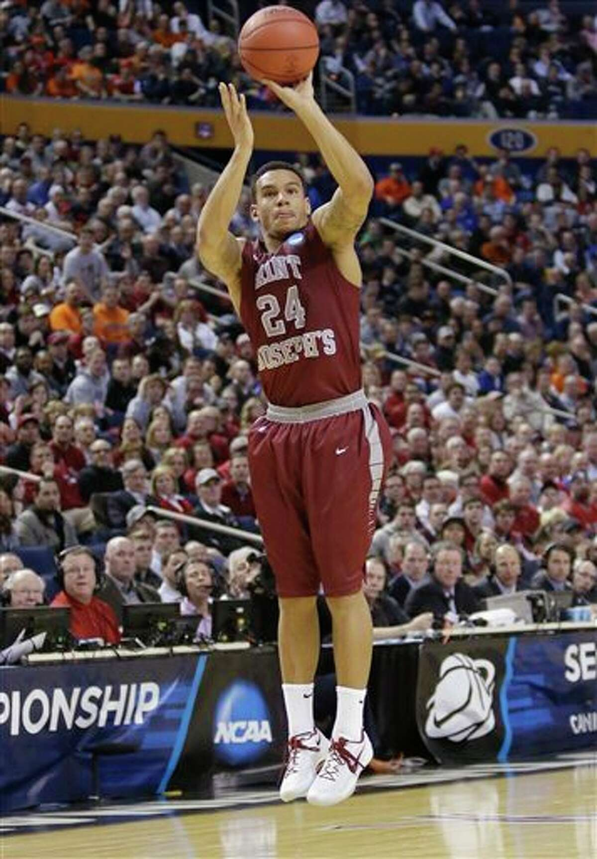Saint Joseph's 's Chris Wilson (24) shoots during the first half of a second-round game against Connecticut in the NCAA college basketball tournament in Buffalo, N.Y., Thursday, March 20, 2014. (AP Photo/Nick LoVerde)