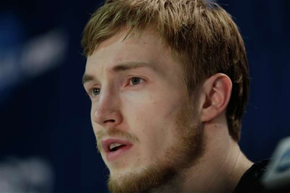 Connecticut's Niels Giffey responds to questions during an NCAA college basketball tournament news conference in Buffalo, N.Y., Friday, March 21, 2014. Connecticut plays Villanova in a third round game on Saturday. (AP Photo/Frank Franklin II)