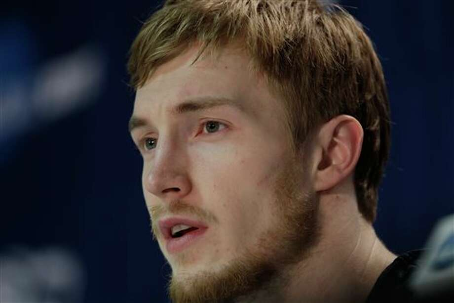 Connecticut's Niels Giffey responds to questions during an NCAA college basketball tournament news conference in Buffalo, N.Y., Friday, March 21, 2014. Connecticut plays Villanova in a third round game on Saturday. (AP Photo/Frank Franklin II) / AP