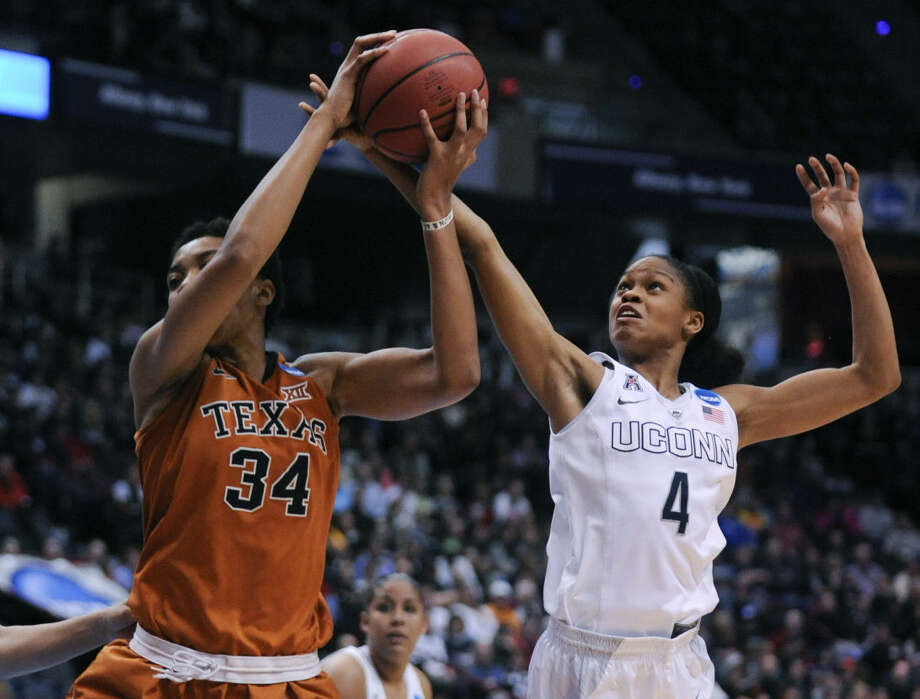 Connecticut guard Moriah Jefferson (4) defends against Texas center Imani McGee-Stafford (34) during the first half of a women's college basketball regional semifinal game in the NCAA Tournament on Saturday, March 28, 2015, in Albany, N.Y. (AP Photo/Tim Roske)