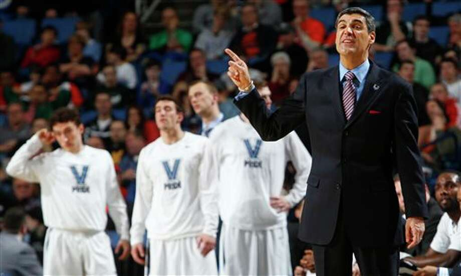 Villanova coach Jay Wright calls out to his team during the second half of a third-round game against Connecticut in the NCAA men's college basketball tournament in Buffalo, N.Y., Saturday, March 22, 2014. (AP Photo/Bill Wippert) / FR170745 AP