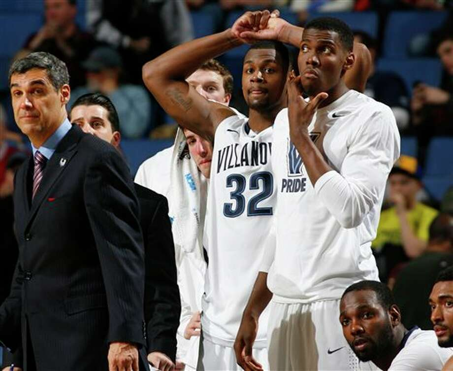 Villanova head coach Jay Wright watches during the second half of a third-round game against Connecticut in the NCAA men's college basketball tournament in Buffalo, N.Y., Saturday, March 22, 2014. Connecticut won the game 77-65. (AP Photo/Bill Wippert) / FR170745 AP