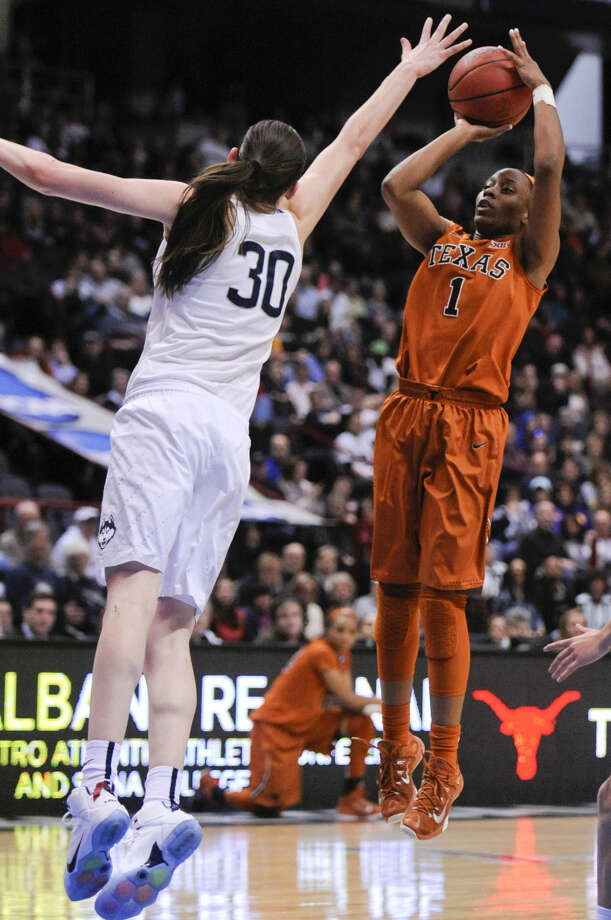 Texas guard Empress Davenport (1) shoots over Connecticut forward Breanna Stewart (30) during the first half of a women's college basketball regional semifinal game in the NCAA Tournament on Saturday, March 28, 2015, in Albany, N.Y. (AP Photo/Tim Roske)