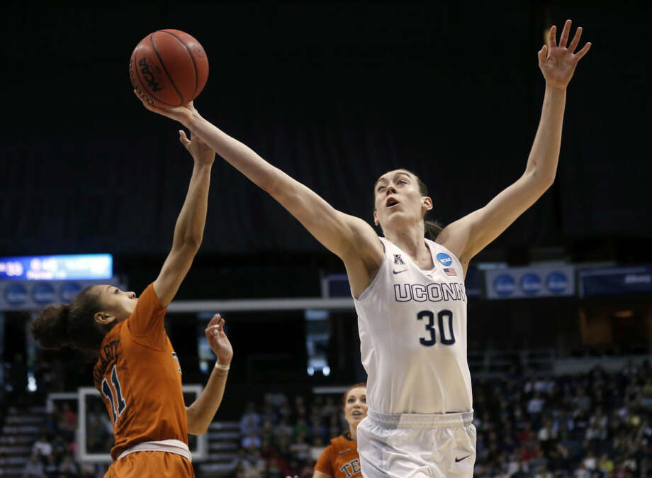 Connecticut forward Breanna Stewart (30) grabs a rebound over Texas guard Brooke McCarty during the first half of a women's college basketball regional semifinal game in the NCAA Tournament on Saturday, March 28, 2015, in Albany, N.Y. (AP Photo/Mike Groll)