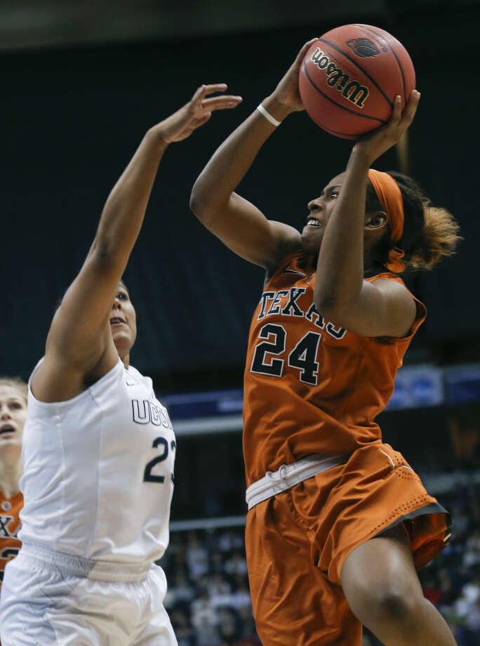 Texas guard Ariel Atkins (24) shoots over Connecticut forward Kaleena Mosqueda-Lewis (23) during the second half of a women's college basketball regional semifinal game in the NCAA Tournament on Saturday, March 28, 2015, in Albany, N.Y. (AP Photo/Mike Groll)