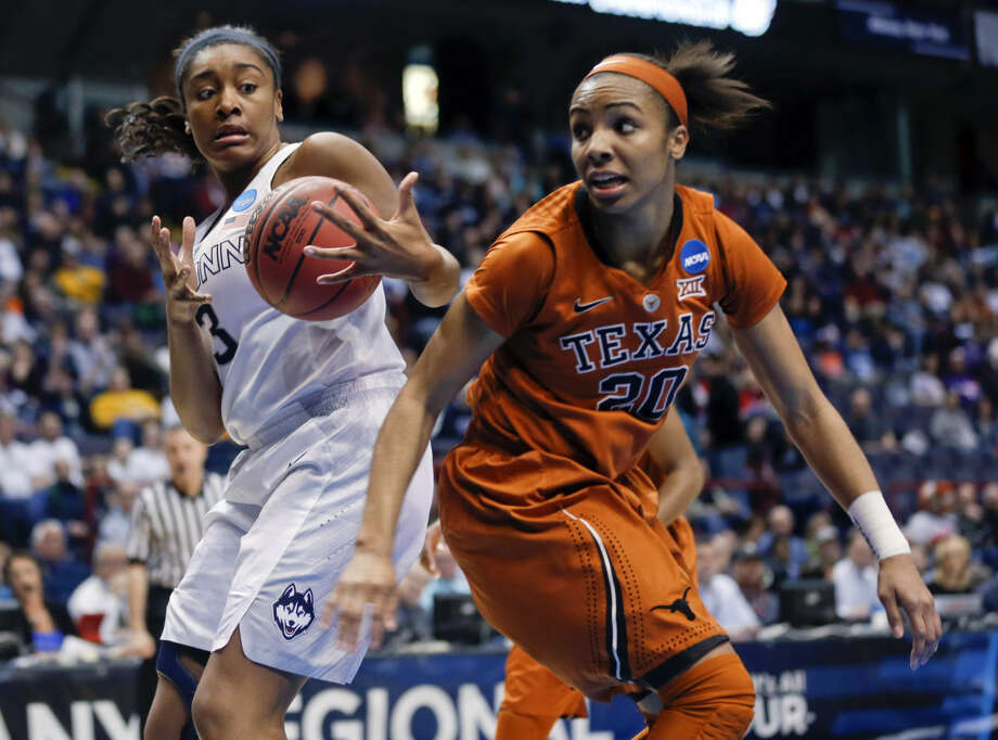 Connecticut forward Morgan Tuck (3) grabs a rebound as Texas guard Brianna Taylor (20) defends during the first half of a women's college basketball regional semifinal game in the NCAA Tournament on Saturday, March 28, 2015, in Albany, N.Y. (AP Photo/Mike Groll)