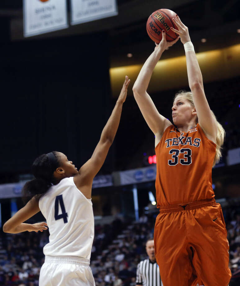 Texas forward Sara Hattis (33) shoots over Connecticut guard Moriah Jefferson (4) during the second half of a women's college basketball regional semifinal game in the NCAA Tournament on Saturday, March 28, 2015, in Albany, N.Y. (AP Photo/Mike Groll)