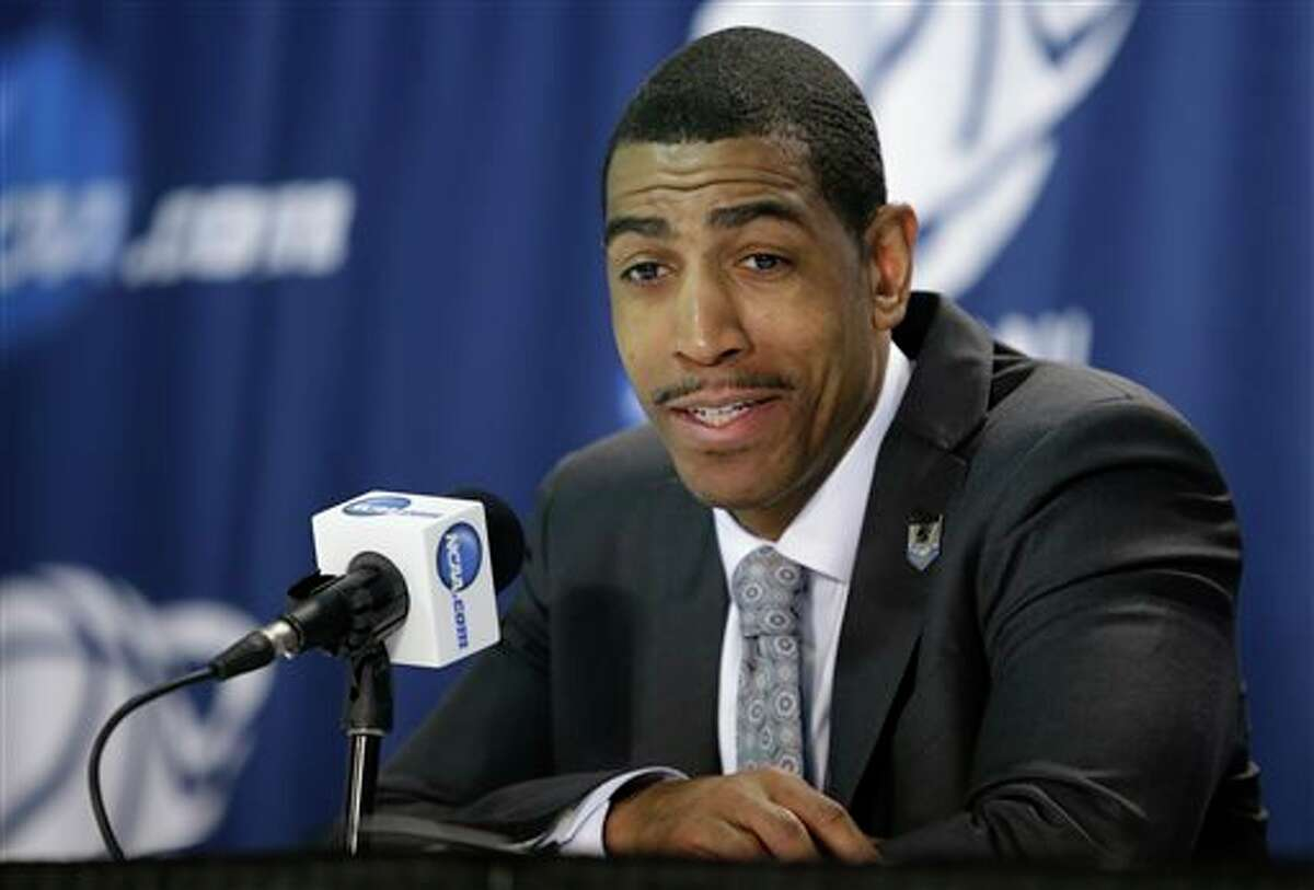 Connecticut head coach Kevin Ollie responds to questions during a news conference after a third-round game against Villanova in the NCAA men's college basketball tournament in Buffalo, N.Y., Sunday, March 23, 2014. Connecticut won the game 77-65. (AP Photo/Nick LoVerde)