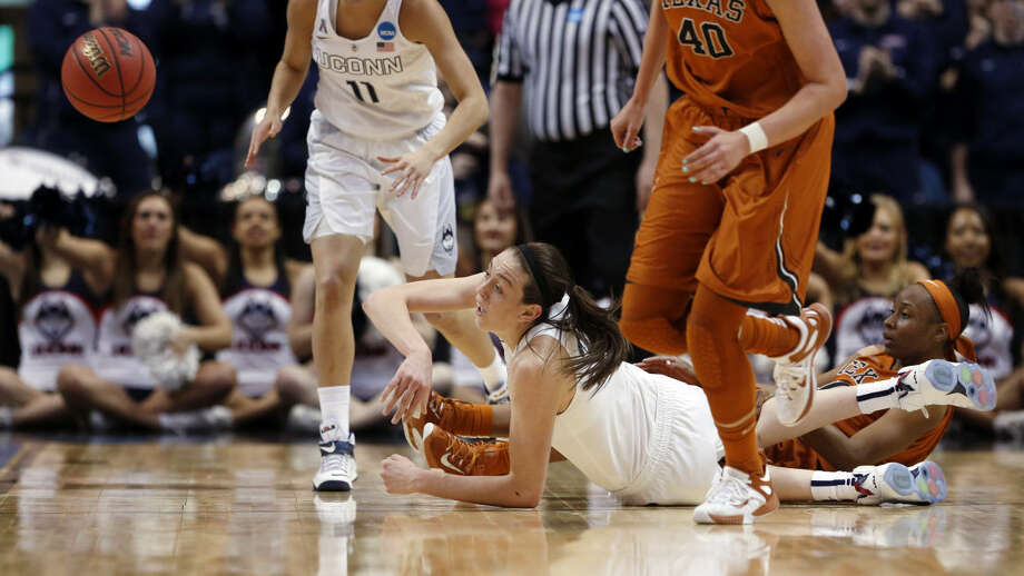 Connecticut forward Breanna Stewart, bottom center, passes to a teammate during the first half of a women's college basketball regional semifinal game against Texas in the NCAA Tournament on Saturday, March 28, 2015, in Albany, N.Y. (AP Photo/Mike Groll)