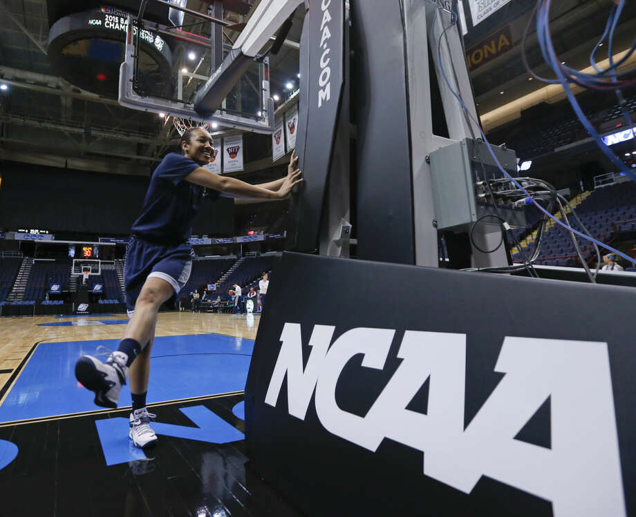 Connecticut guard Saniya Chong warms up during practice for a women's college basketball regional semifinal game in the NCAA Tournament on Friday, March 27, 2015, in Albany, N.Y. UConn plays Texas on Saturday. (AP Photo/Mike Groll)