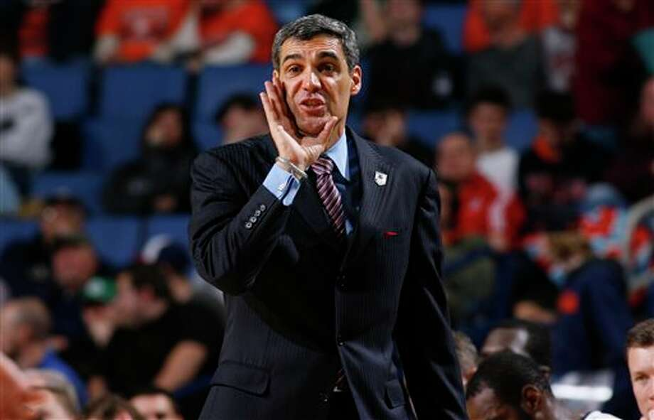 Villanova head coach Jay Wright calls out to his team during the second half of a third-round game against Connecticut in the NCAA men's college basketball tournament in Buffalo, N.Y., Saturday, March 22, 2014. Connecticut won the game 77-65. (AP Photo/Bill Wippert) / FR170745 AP