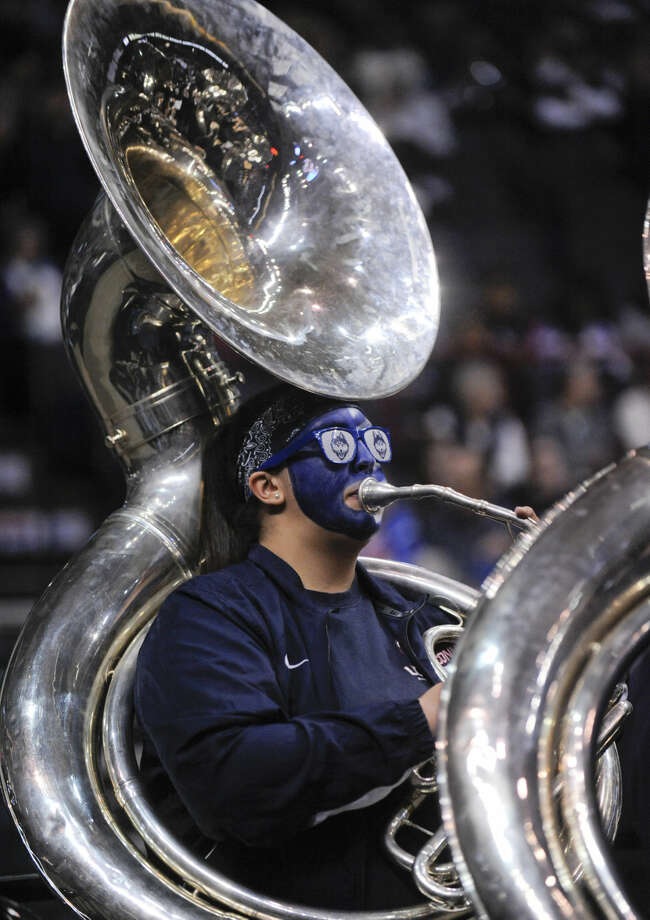 A member of the Connecticut pep band plays during the first half of a women's college basketball regional semifinal game between Connecticut and Texas in the NCAA Tournament on Saturday, March 28, 2015, in Albany, N.Y. (AP Photo/Tim Roske)