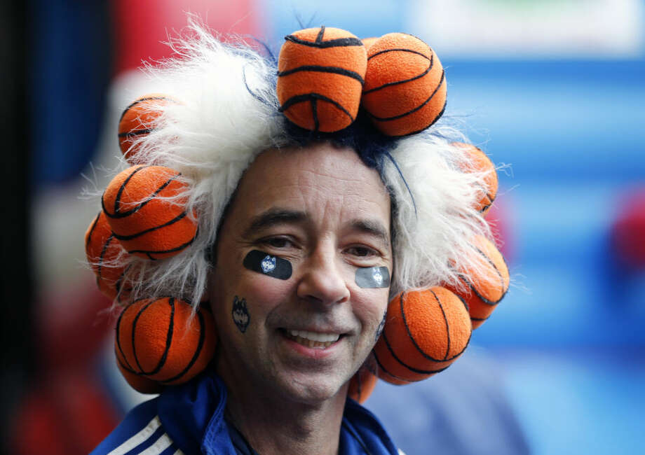 Connecticut fan Danny Karwoski of Stamford, Conn., waits outside the Times Union Center before a women's college basketball regional semifinal game in the NCAA Tournament between Texas and Connecticut on Saturday, March 28, 2015, in Albany, N.Y. (AP Photo/Mike Groll)