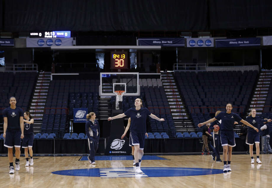 Connecticut players warm up during practice for a women's college basketball regional semifinal game in the NCAA Tournament on Friday, March 27, 2015, in Albany, N.Y. UConn plays Texas on Saturday. (AP Photo/Mike Groll)