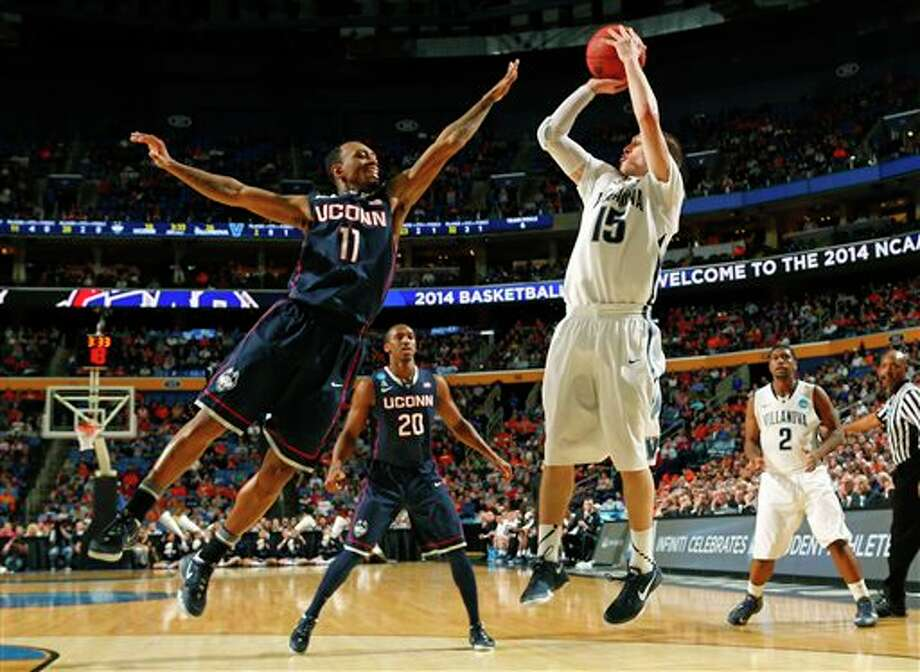 Villanova's Ryan Arcidiacono (15) shoots over Connecticut's Ryan Boatright (11) during the first half of a third-round game in the NCAA men's college basketball tournament in Buffalo, N.Y., Saturday, March 22, 2014. (AP Photo/Bill Wippert) / FR170745 AP