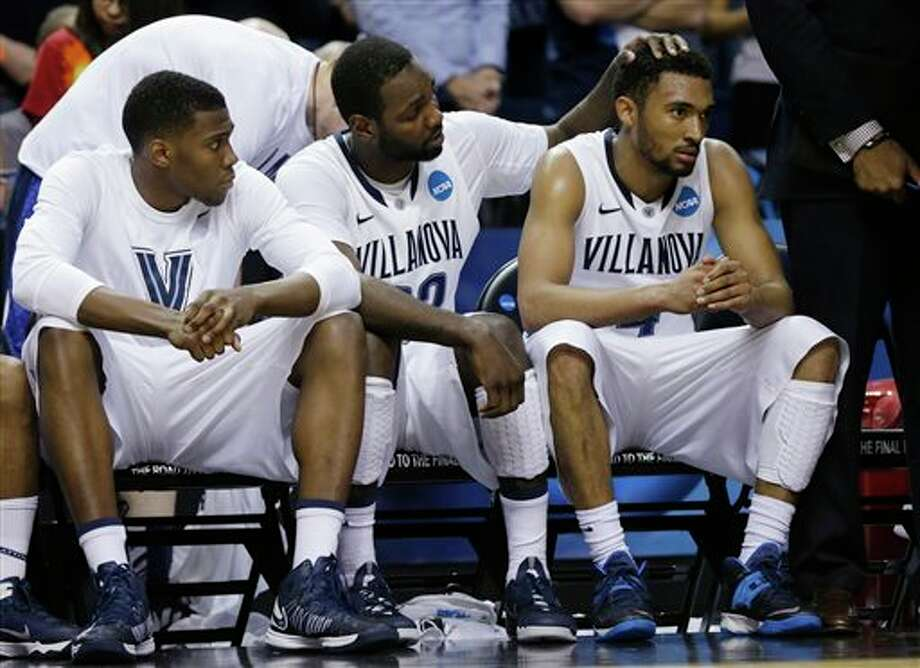 Villanova's JayVaughn Pinkston (22) and Darrun Hilliard II (4) react with teammates during the second half of a third-round game in the NCAA men's college basketball tournament in Buffalo, N.Y., Sunday, March 23, 2014. (AP Photo/Frank Franklin II) / AP
