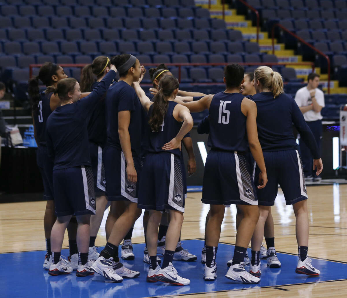 Connecticut players gather during practice for a women's college basketball regional semifinal game in the NCAA Tournament on Friday, March 27, 2015, in Albany, N.Y. UConn plays Texas on Saturday. (AP Photo/Mike Groll)
