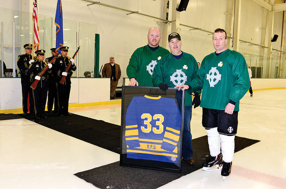 Hour photo / Erik Trautmann The Norwalk PoliceUnion retires No. 33 as they hold a benefit hockey game for recently retired NPD Lt. Timothy Murphy Saturday at SoNo Ice House.