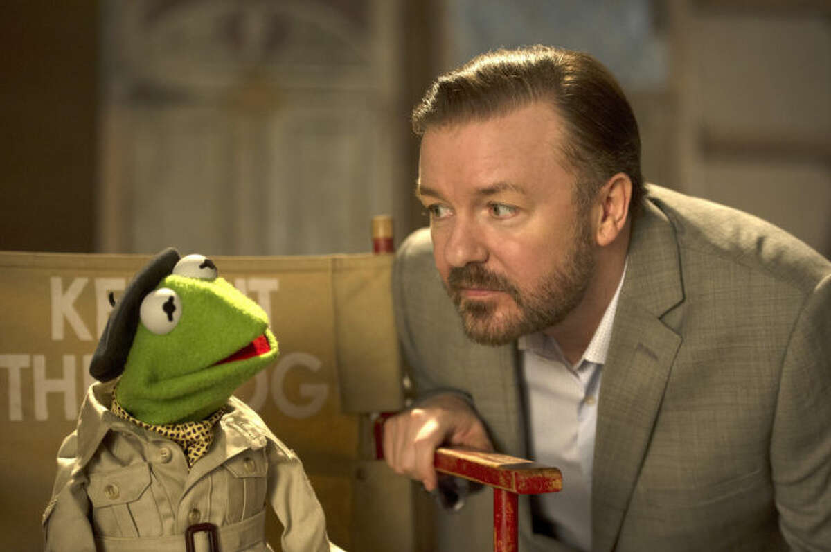 This image released by Disney shows the muppet character Kermit the frog, left, and Ricky Gervais in a scene from
