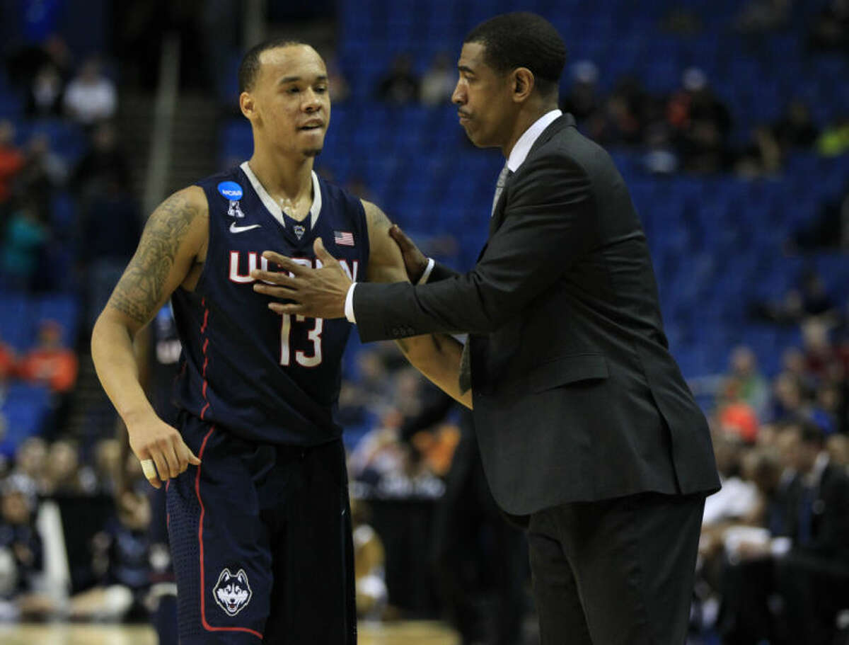 UConn player Shabazz Napier is congratulated by head coach Kevin Ollie in the closing seconds of play against Villanova during the second half of the third-round game in the men's NCAA college basketball tournament at the First Niagara Center, Sunday, March 23, 2014. (AP Photo/\Harry Scull Jr./Buffalo News)